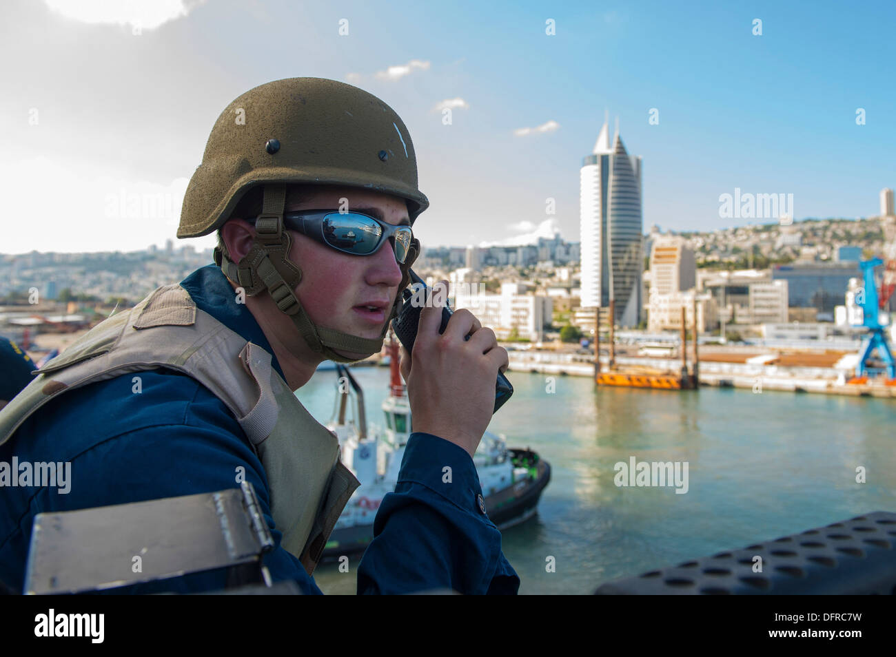 Gunner's Mate 3rd Class James Ross calls in a surface contact during watch aboard the guided-missile destroyer USS Gravely (DDG - Stock Image