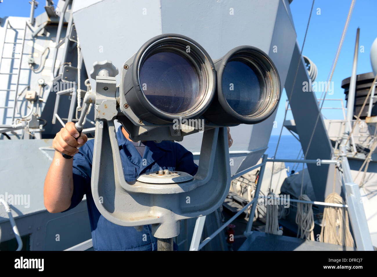 Boatswain's Mate Seaman Daniel Murphy stands watch as forward port side lookout aboard the guided-missile destroyer USS Ramage (DDG 61). Ramage, homeported in Norfolk, is on a scheduled deployment supporting maritime security operations and theater securi - Stock Image
