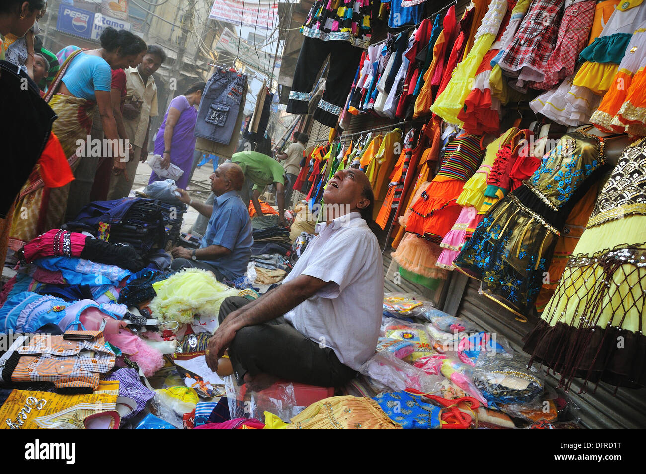 Selling clothe on the street, Delhi India - Stock Image