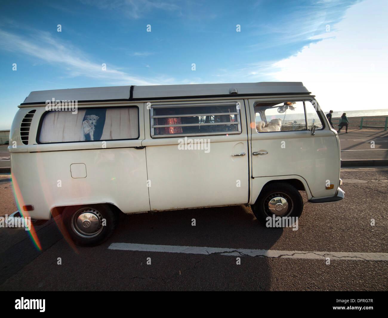A VW camper van drives along the seafront in Brighton - Stock Image