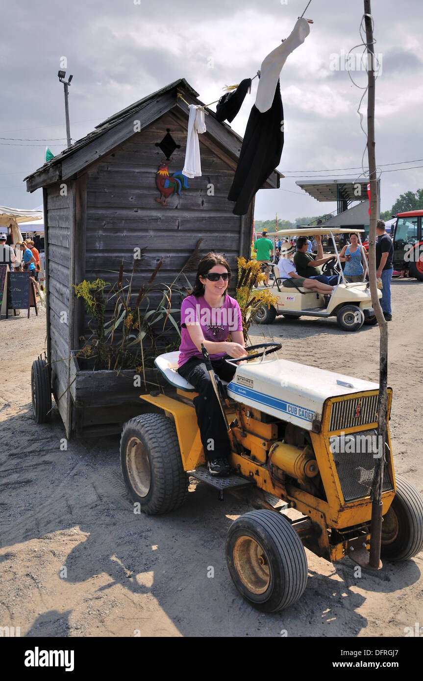 Small Tractor Pulling A Garden Garden Shed And Washing Line At