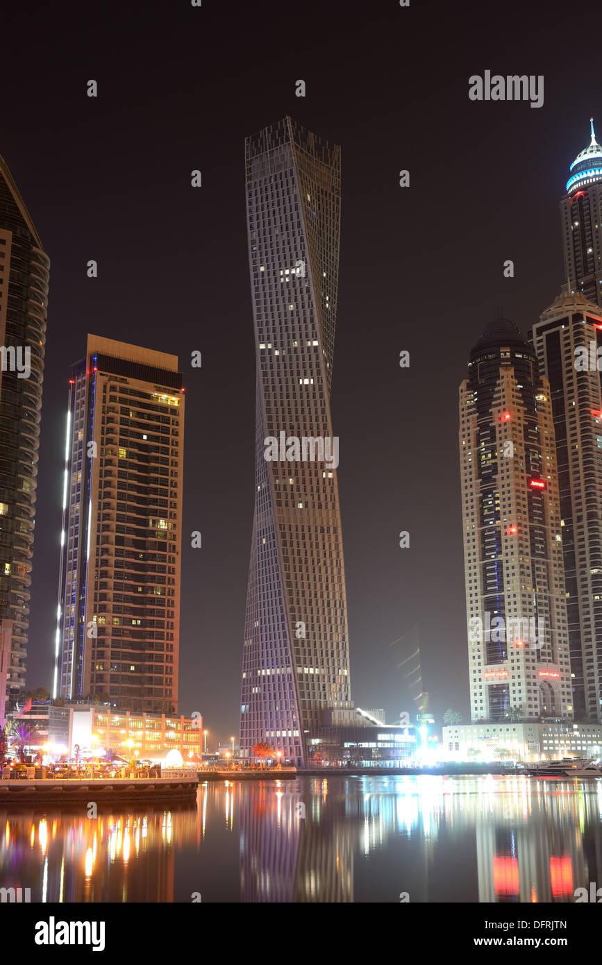 The night illumination at Dubai Marina and Cayan Tower, Dubai, UAE - Stock Image