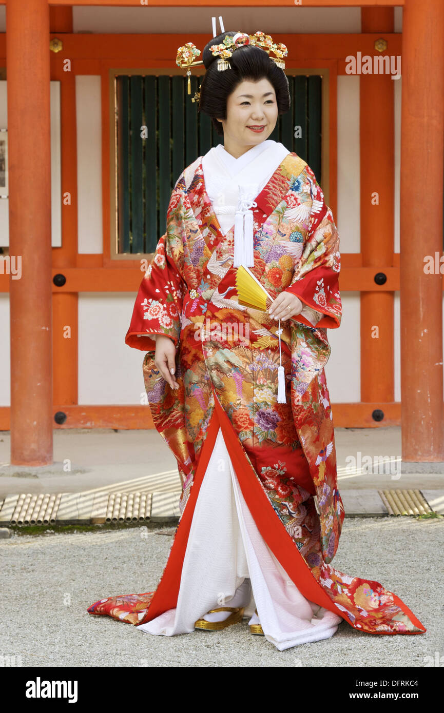 A smiling, just married, Japanese bride wearing a traditional
