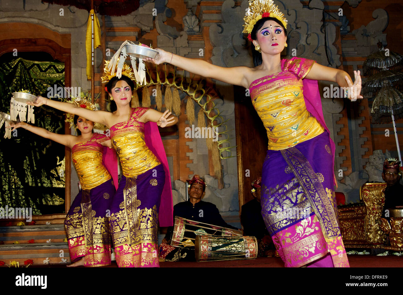 Women In A Traditional Costumes Dancing A Balinese Dance In