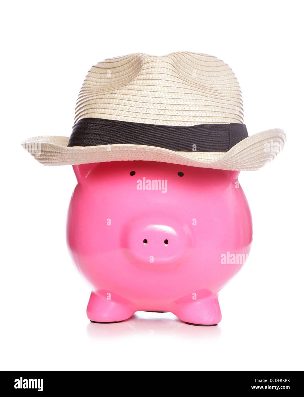 Piggy bank wearing a posh hat cut out - Stock Image