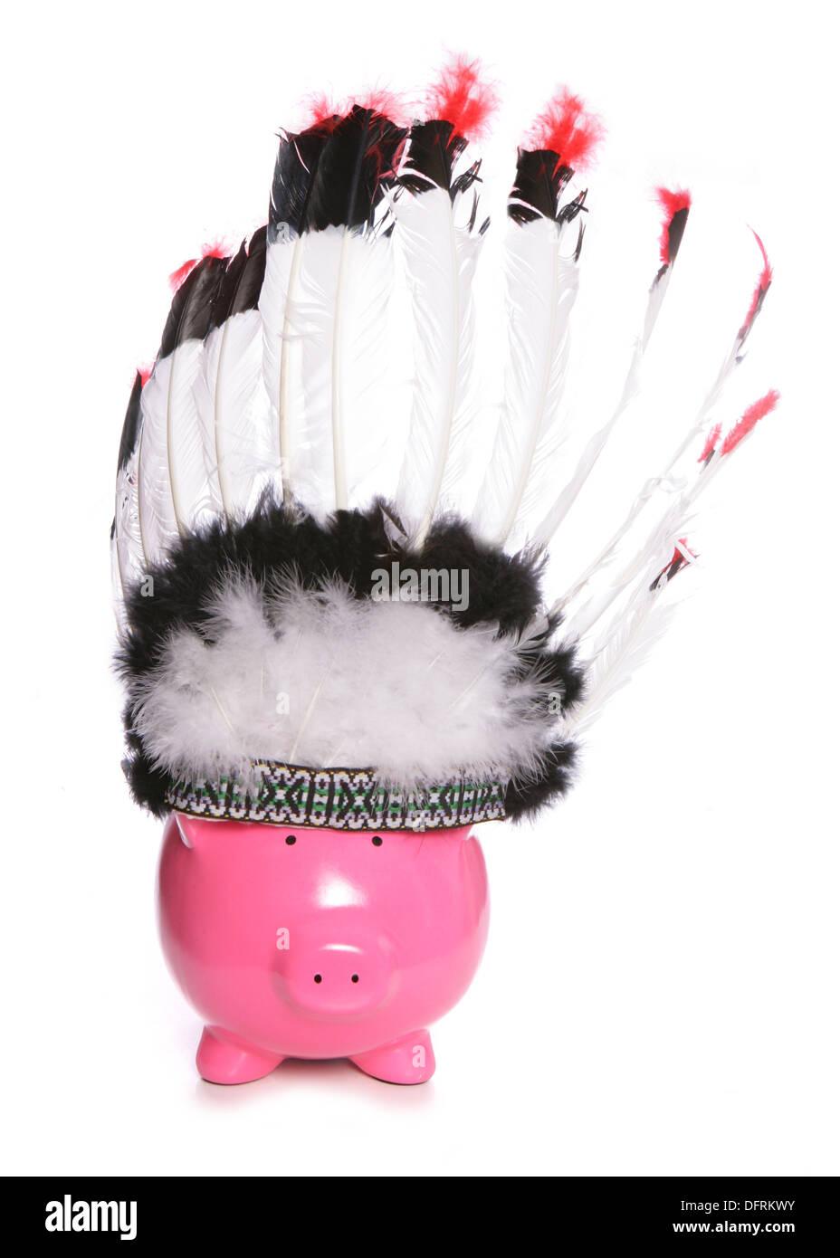 Piggy bank wearing a red indian headdress cutout - Stock Image