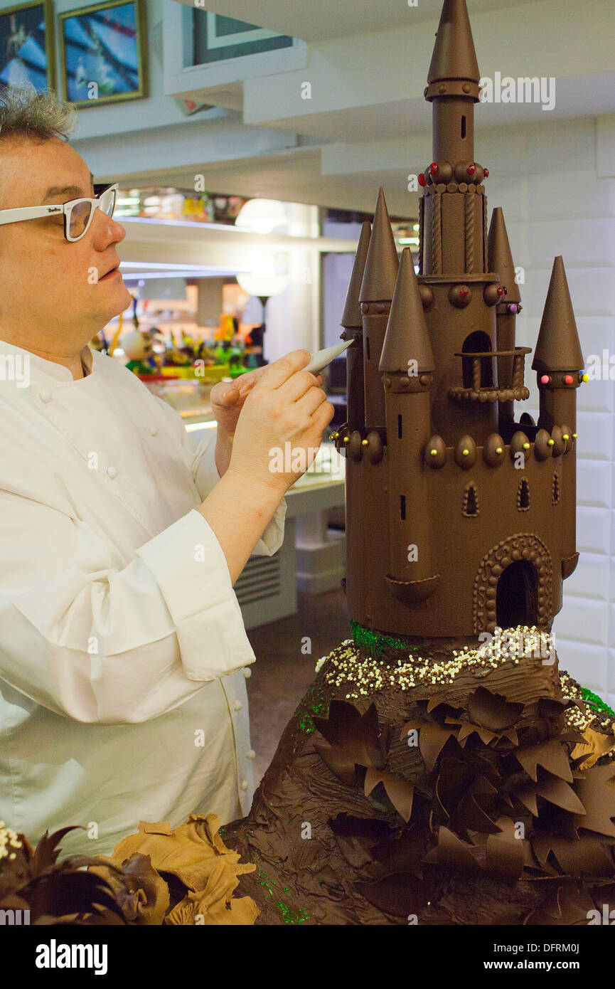 Christian Escriba making a `Mona´, typical chocolate cake of Pascua´s monday - Stock Image