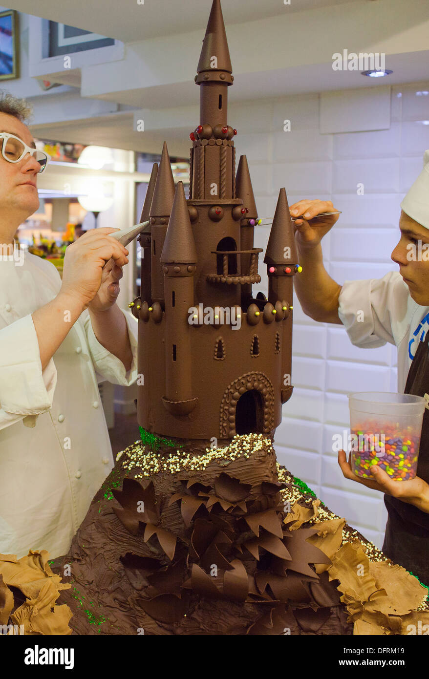 Christian Escriba and an assistant making a `Mona´, typical chocolate cake of Pascua´s monday - Stock Image