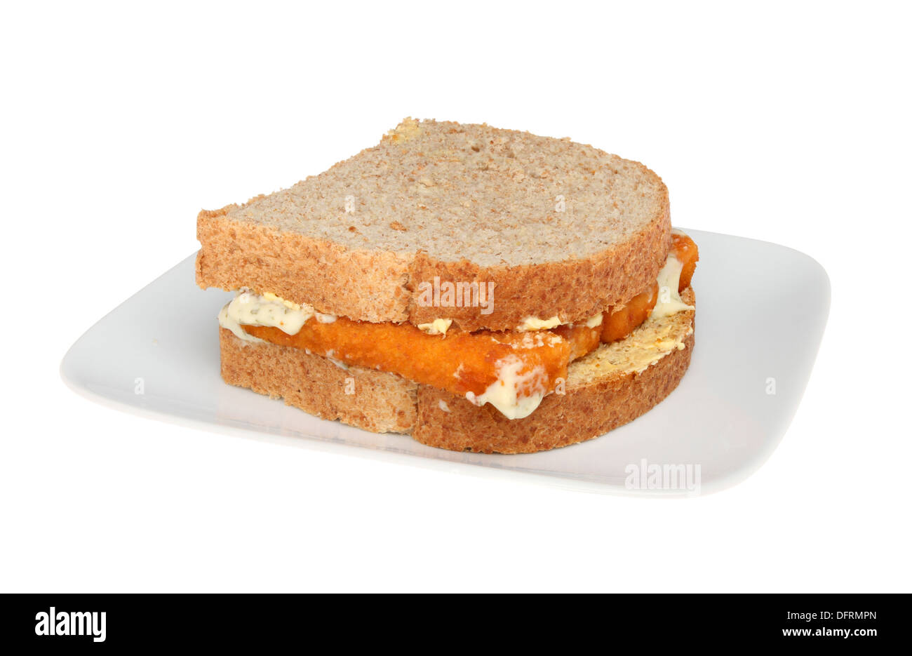 Fish finger sandwich on a plate isolated against white - Stock Image