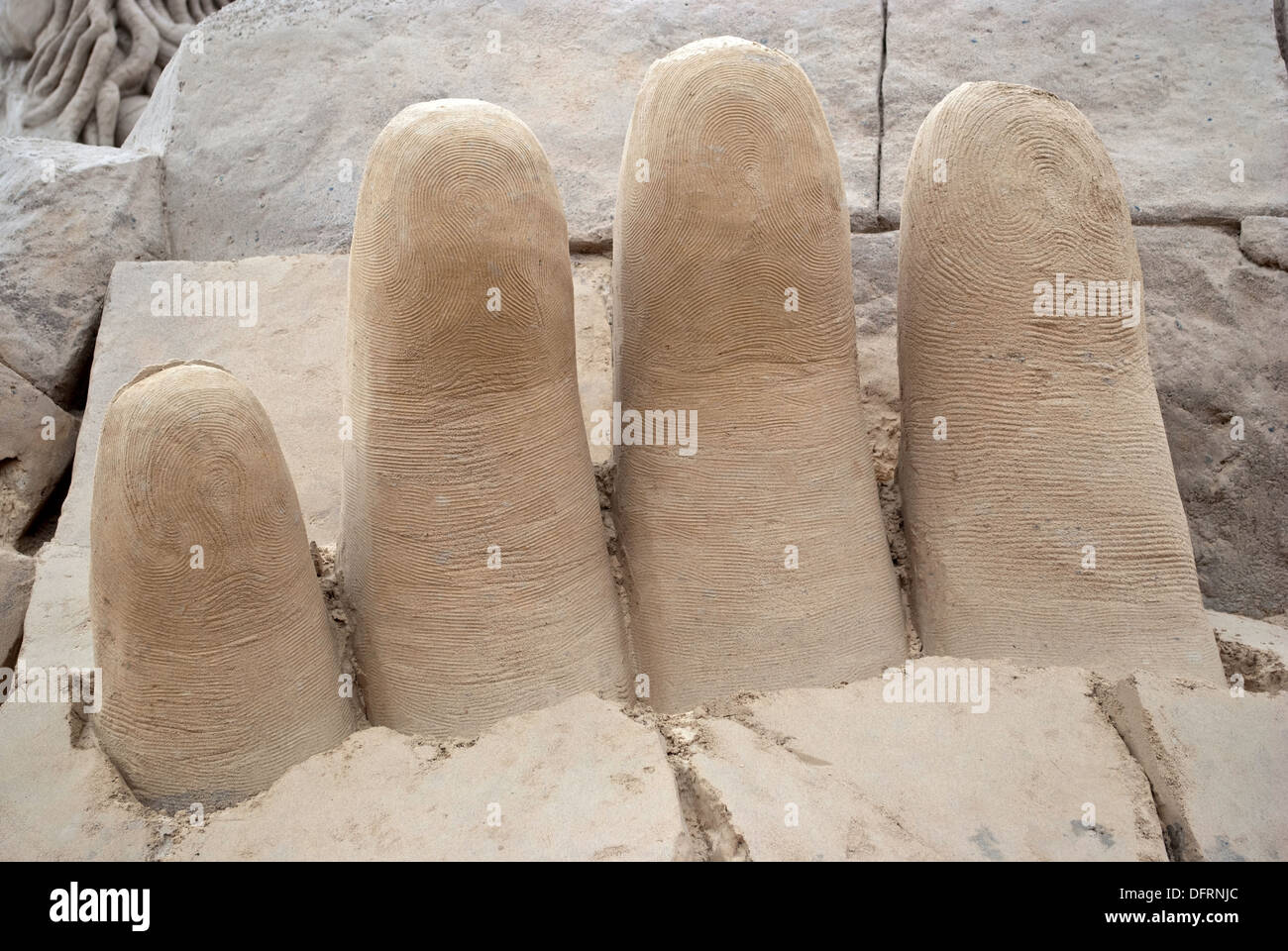 Fingers of sand on the city beach. - Stock Image