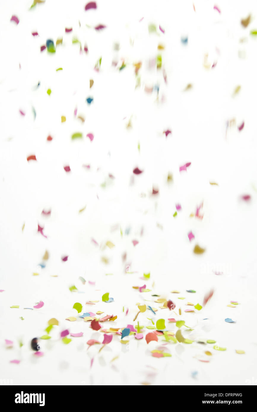 confetti falling against white background with motion blur effect - Stock Image