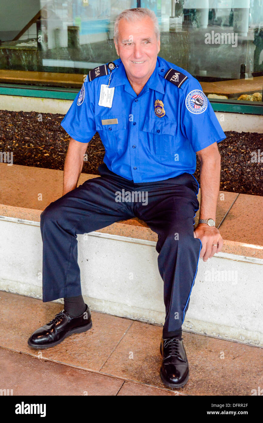 TSA Agent in uniform takes a break at Sarasota Bradenton International Airport, Sarasota, FL - Stock Image