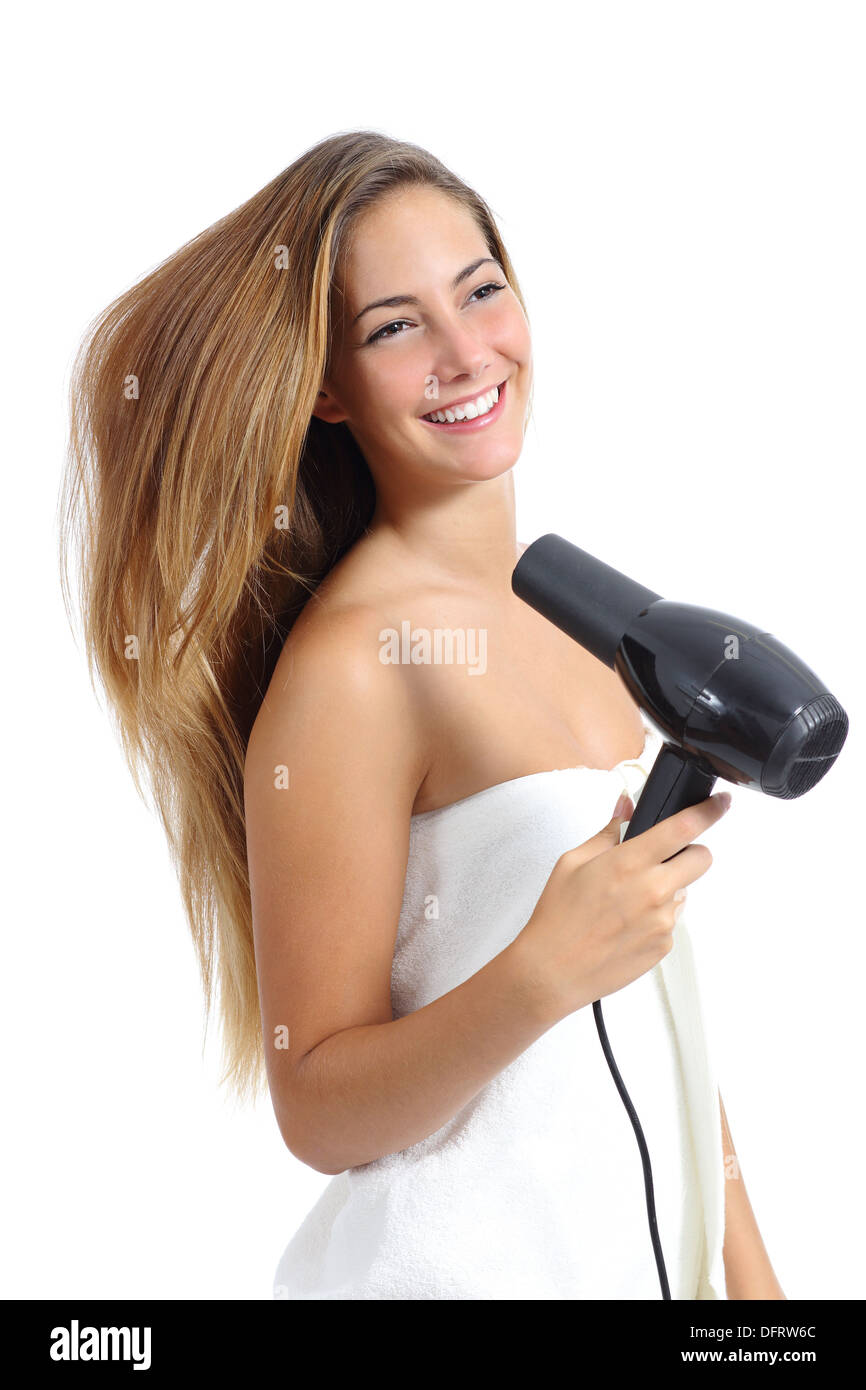 Beautiful woman with a towel drying hair with a dryer isolated on a white background - Stock Image