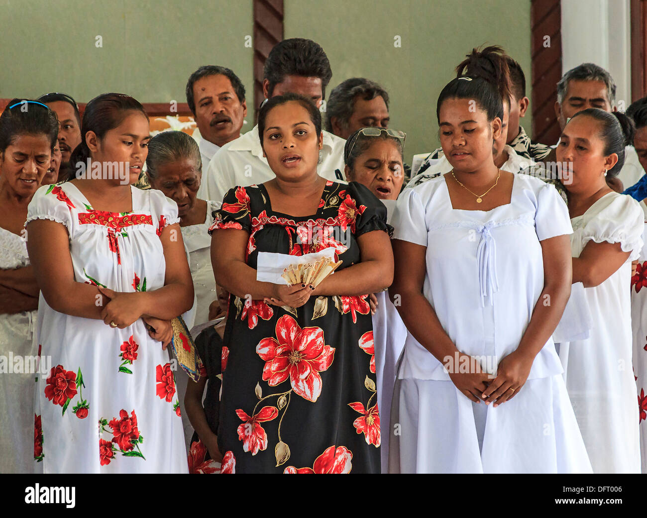 Micronesian women dressed in white lace sing four part choral harmony during church service in Tafunsak, Kosrae, Micronesia - Stock Image