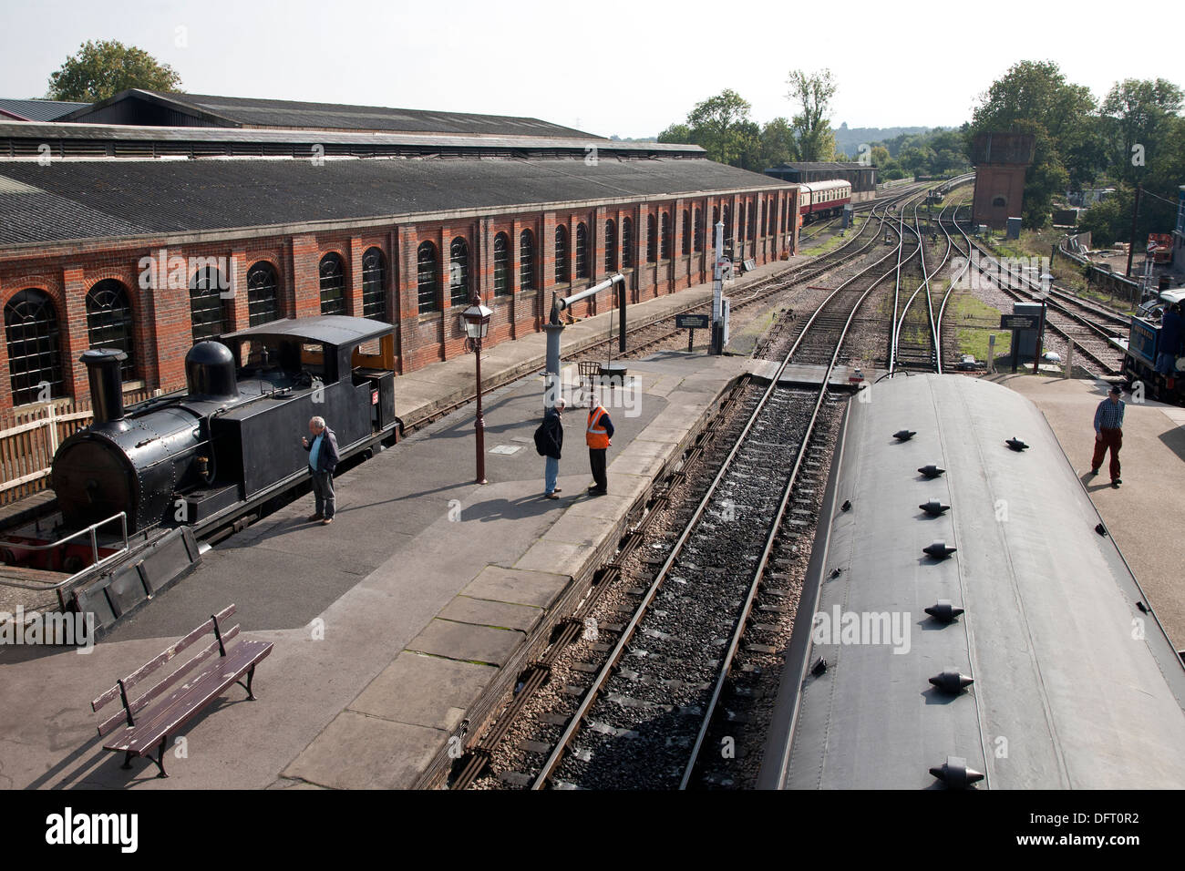 Sheffield Park Station platform and steam engine on Bluebell Railway - Stock Image