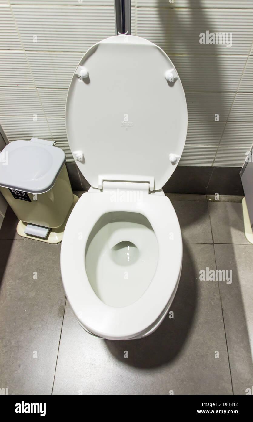 White flush toilet and lavatory pan Stock Photo: 61380174 - Alamy
