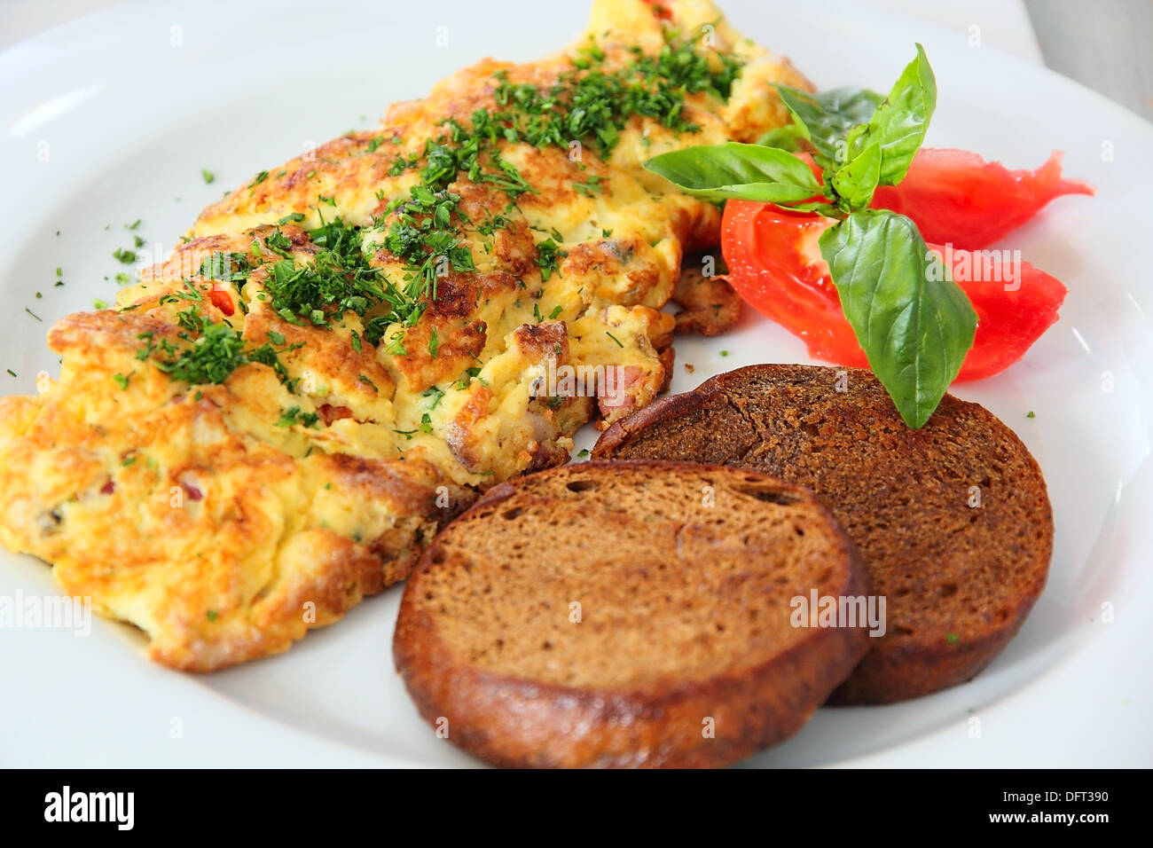 Omelet with grilled toast at the table - Stock Image