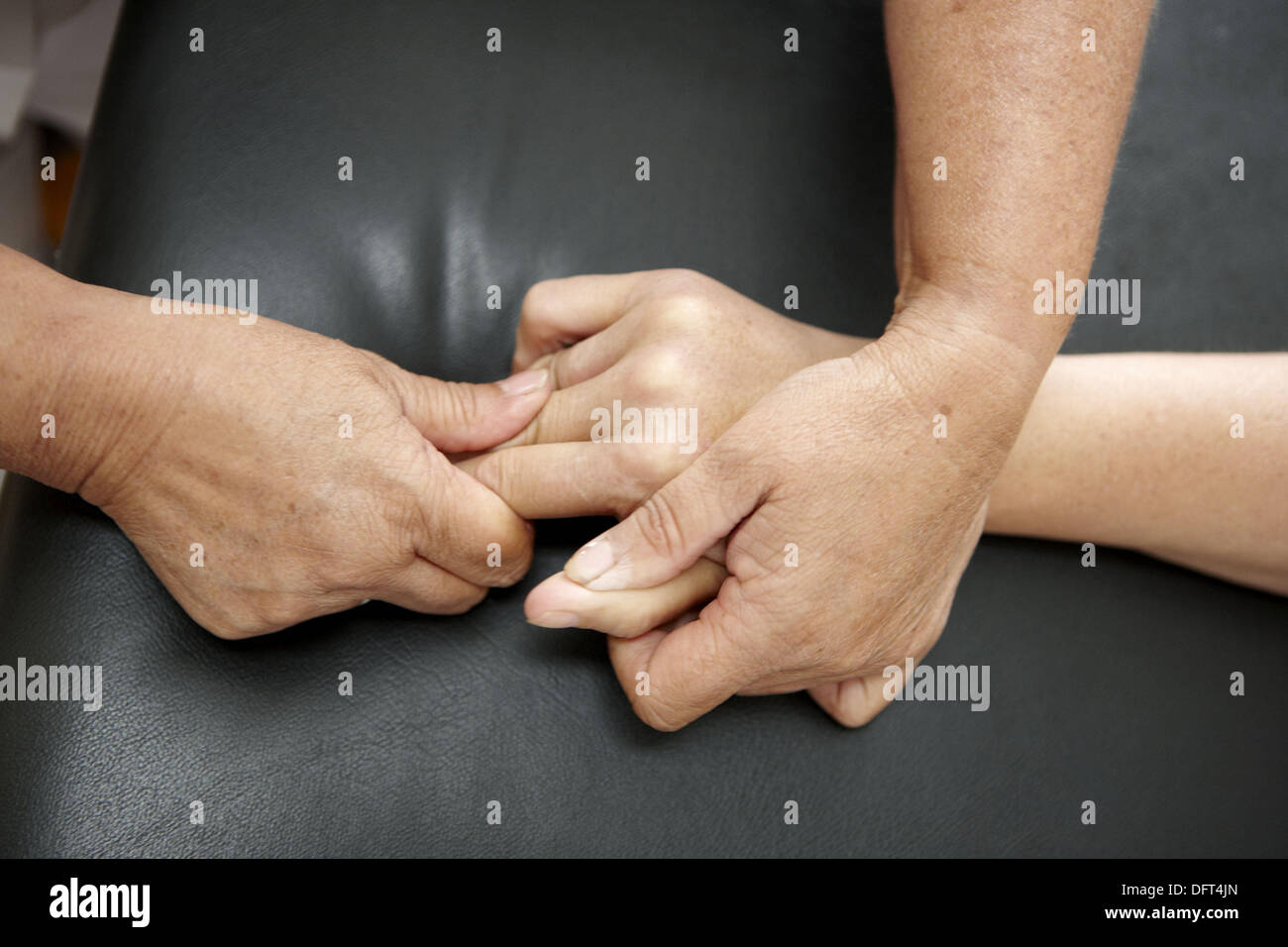 Occupational therapy, physiotherapy, hands: relaxing exercise, hemiplegia, stroke. Hospital Universitario de Gran Canaria - Stock Image