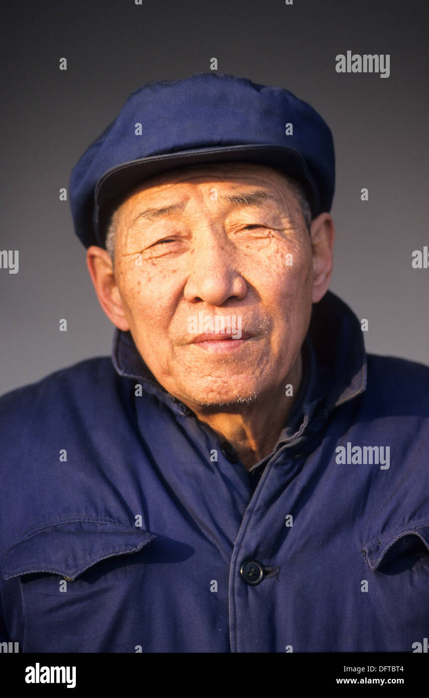 Portrait of old Chinese man wearing his traditional hat and costume from communist period Beijing China  sc 1 st  Alamy & Portrait of old Chinese man wearing his traditional hat and costume ...