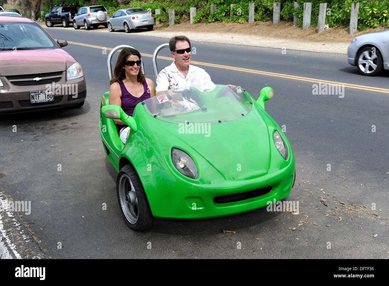 a62af7e42485de Couple in mini rental car visit honolulu hawaii oahu pacific ocean - Stock  Image