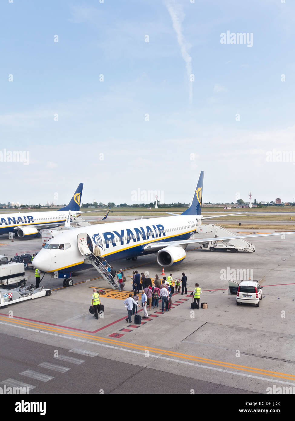 Passengers boarding a Ryanair flight, Bologna airport, Italy - Stock Image