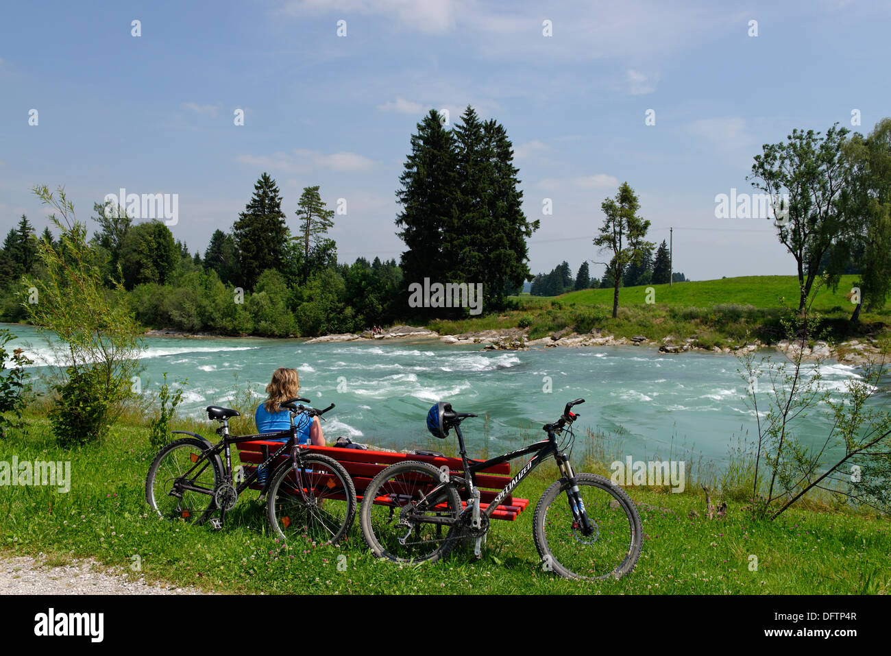 Cyclists during a break at the Lech river, Way of St James, Lechbruck am See, Swabia, Bavaria, Germany - Stock Image
