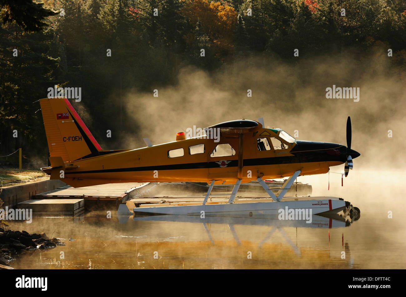 Seaplane on Smoke Lake in the morning mist, Algonquin Provincial Park, Ontario Province, Canada - Stock Image
