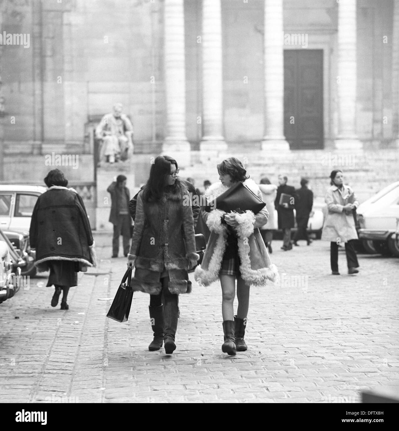 Two students leave the grounds of teh Sorbonne University in the quarter Quartier Latin in Paris, France, in November 1970. The Quartier Latin is the traditional student quarter in Paris and is located directly at the Sorbonne University. Photo: Wilfried Glienke - Stock Image