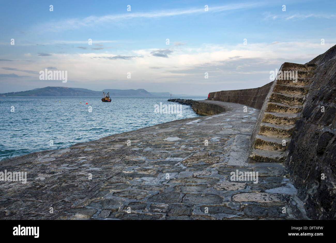 A winters day at The Cobb part of the historic harbour of Lyme Regis on the Jurassic Coast in Dorset - Stock Image