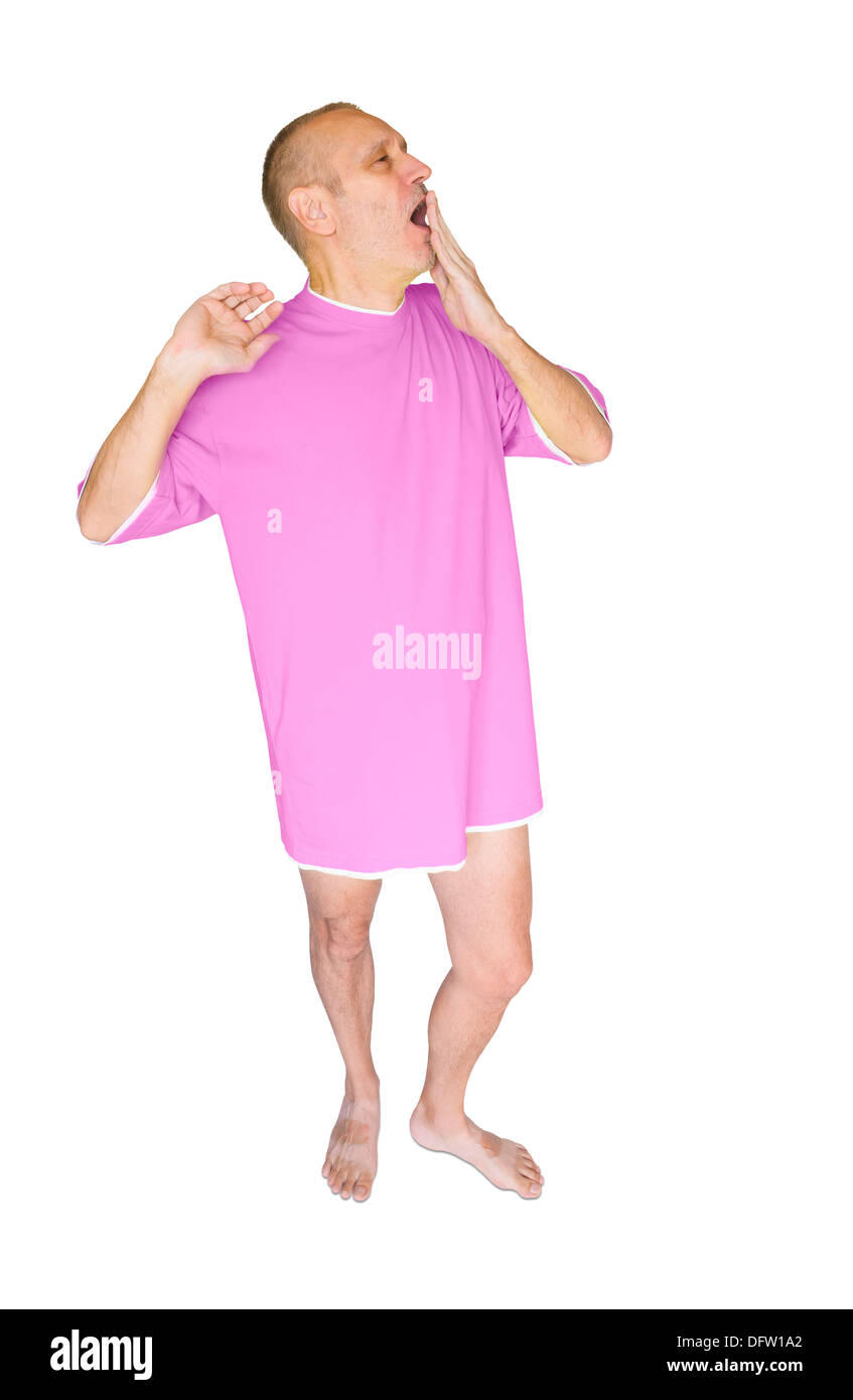 Man in pink nightdress, waking up and yawning, on white background - Stock Image