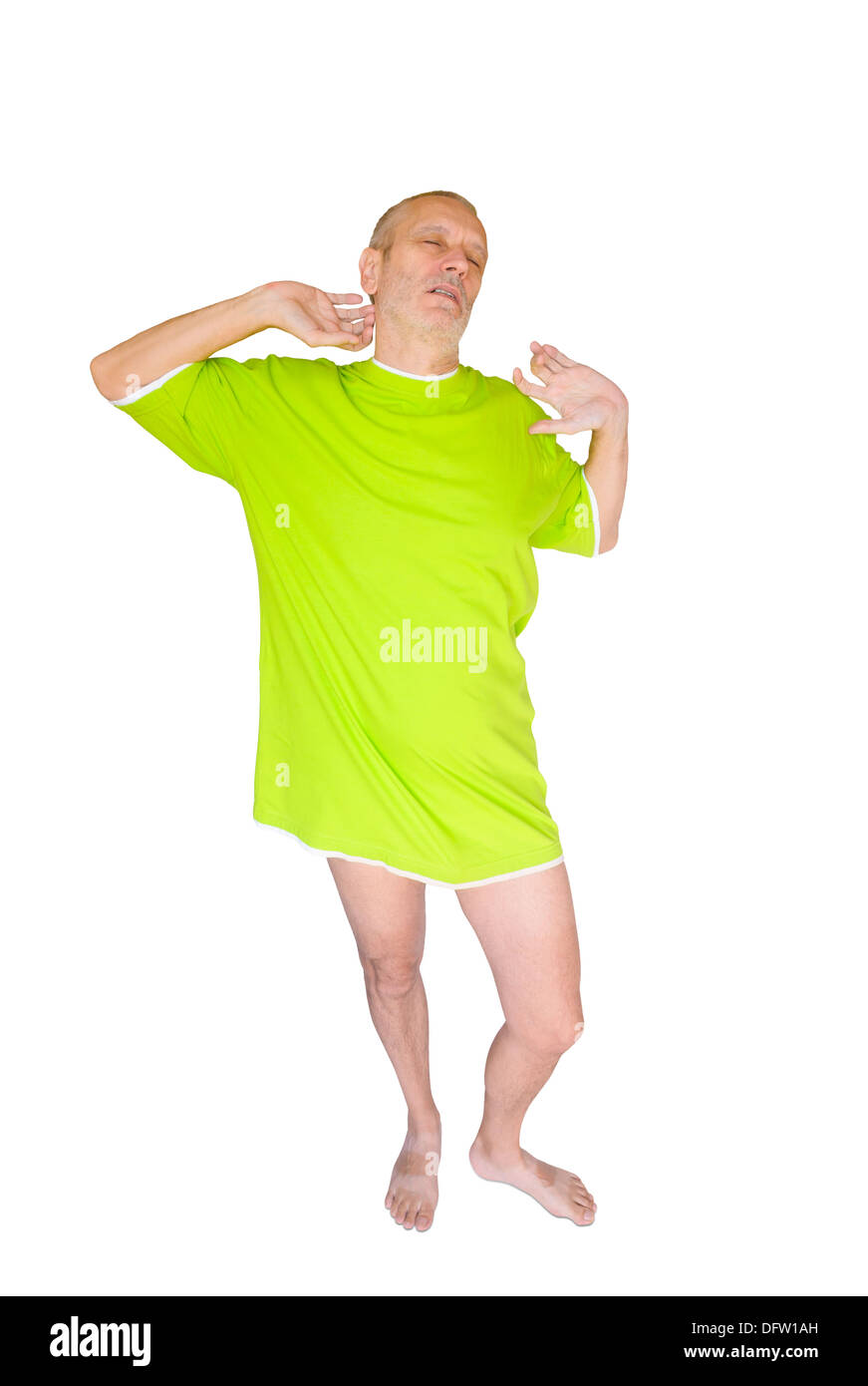 Man in green nightdress, waking up and yawning, on white background - Stock Image