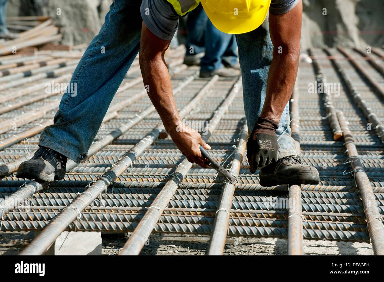 Man working on steel reinforcement for the Panama Canal expansion project  Panama Canal,Panama City,Panama,Central America - Stock Image