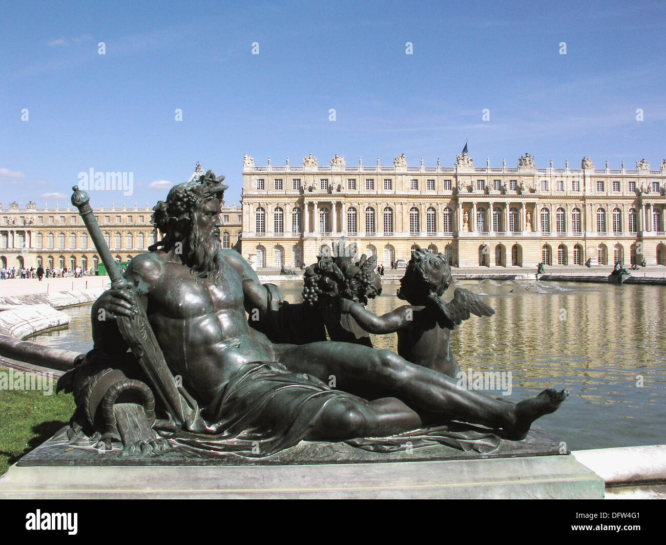 Versailles, France: A statue of Poseidon sits next to a reflecting pool near the Palace de Versailles. - Stock Image