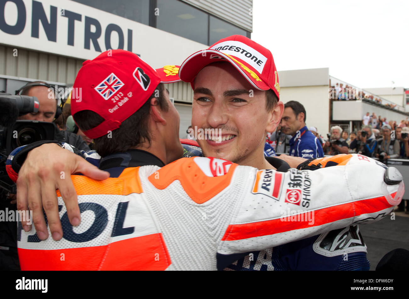 Marc Marquez congratulated Jorge Lorenzo for his win in round 12 of the Hertz FIm MotoGP at Silverstone - Stock Image