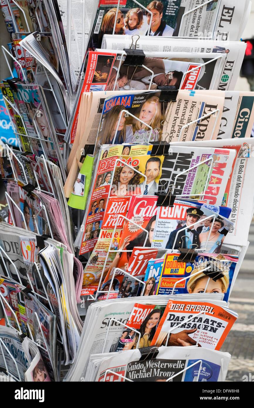 English and foreign language newspapers and magazines at a newsstand in Lisbon, Portugal, Europe Stock Photo