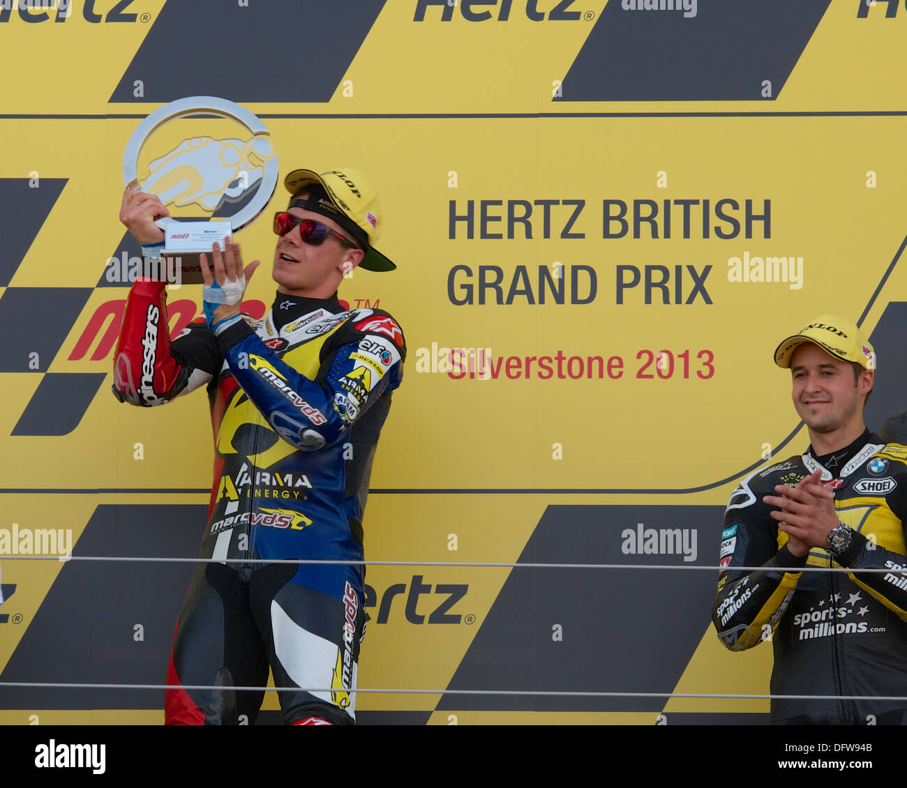 Scott Redding holds up the winners trophy after finishing first in the Moto2 race at Silverstone Circuit - Stock Image