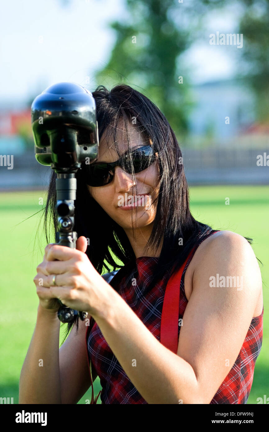 Female paintball player aiming the marker Stock Photo