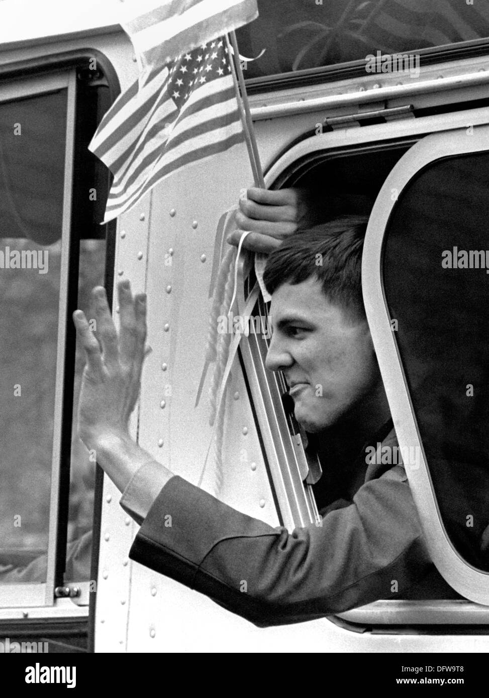 A former American hostage held by Iran waves from a buses during a welcome home parade along Pennsylvania Avenue January 27, 1981 in Washington, DC. Fifty-two Americans were held hostage for 444 days after a group of Iranian students supporting the Iranian Revolution took over the US Embassy in Tehran. - Stock Image