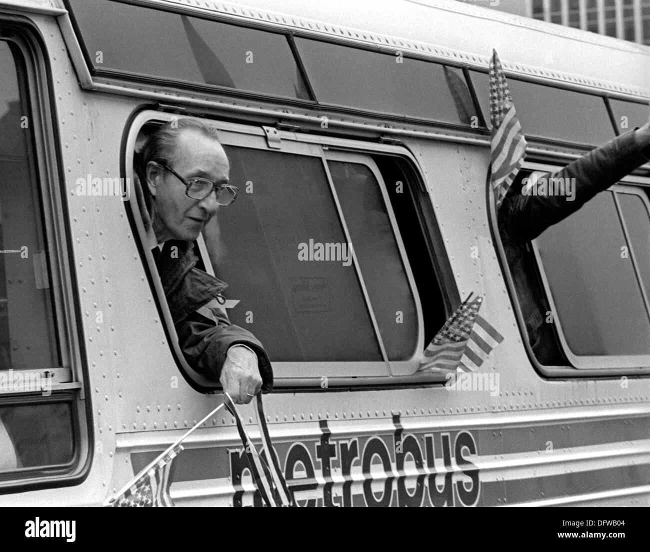 A former American hostage held by Iran waves from a buses during a welcome home parade along Pennsylvania Avenue - Stock Image