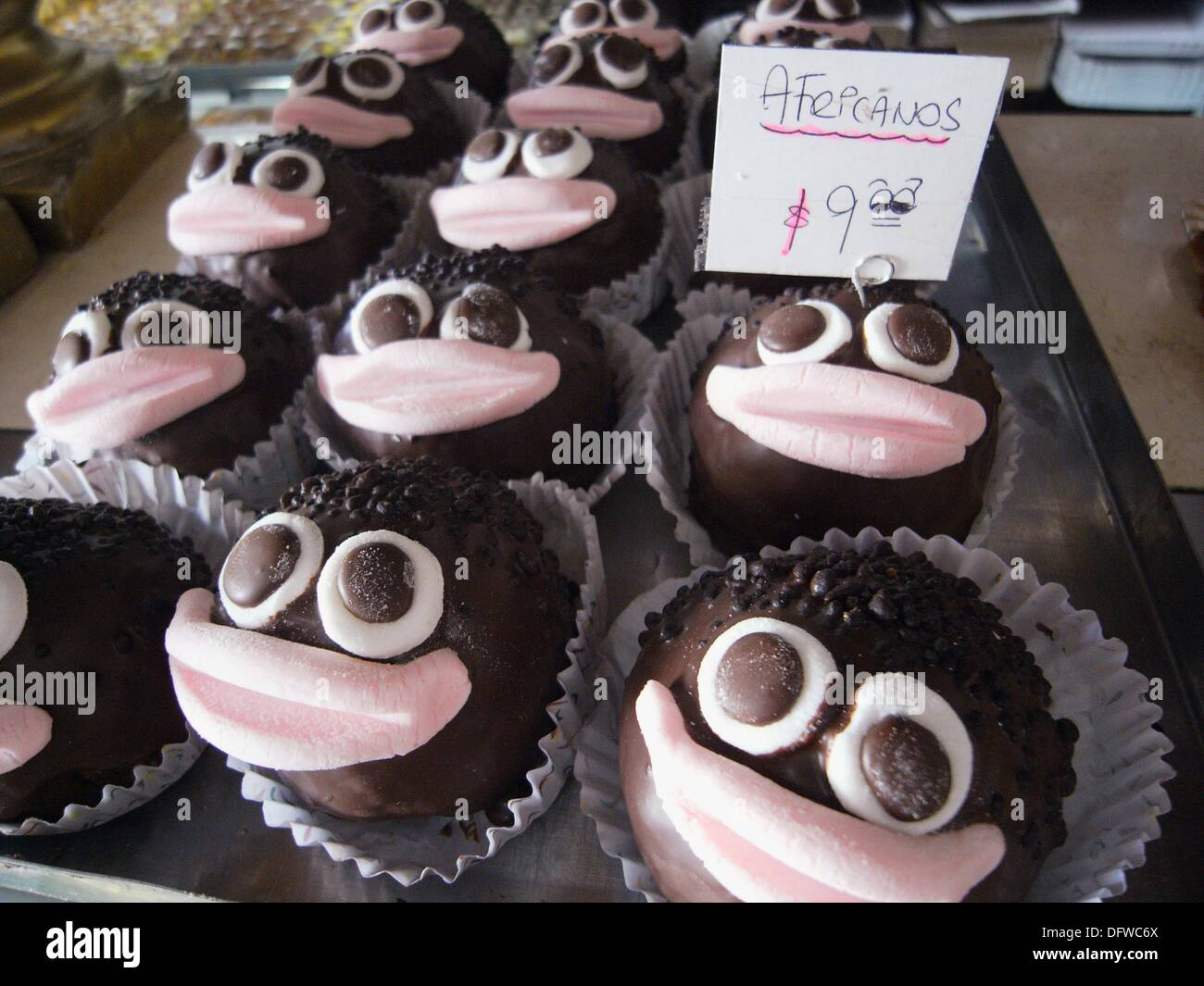 Deliciously politically incorrect - Africano cakes for sale at a confiteria, Buenos Aires, Argentina - Stock Image
