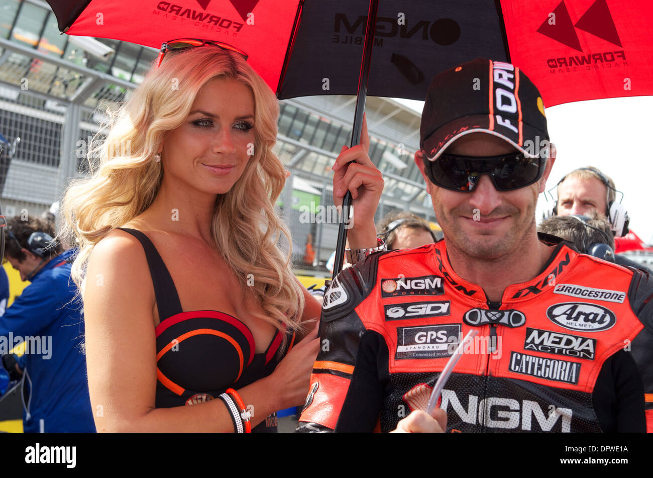 Colin Edwards waits on the Silverstone start grid with his NGM Grid Girl for the start of the British Grand Prix - Stock Image