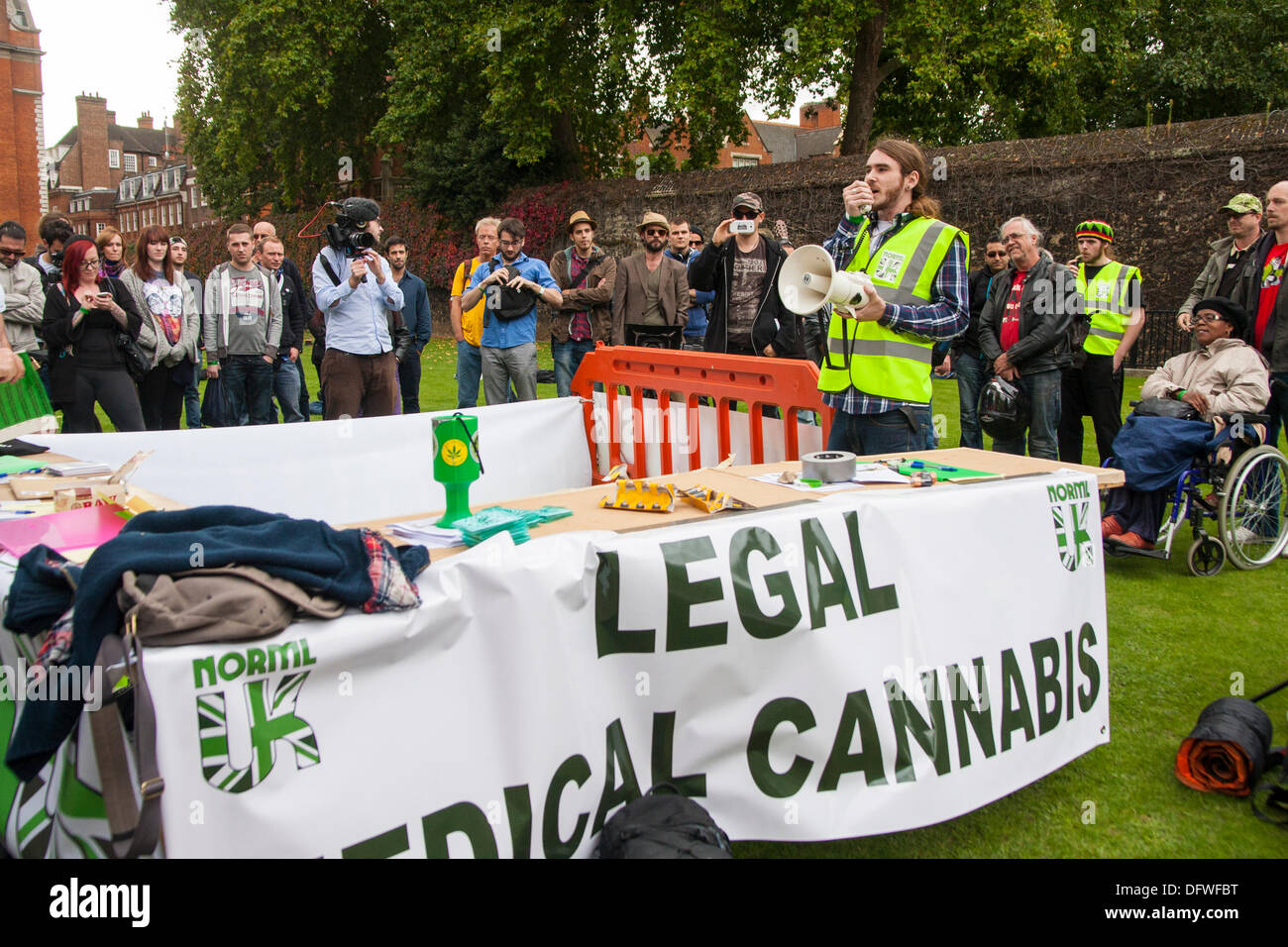 London, UK. 09th Oct, 2013. Part of the 100-strong crowd as NORML UK protest outside Parliament for cannabis law reform. Credit:  Paul Davey/Alamy Live News - Stock Image