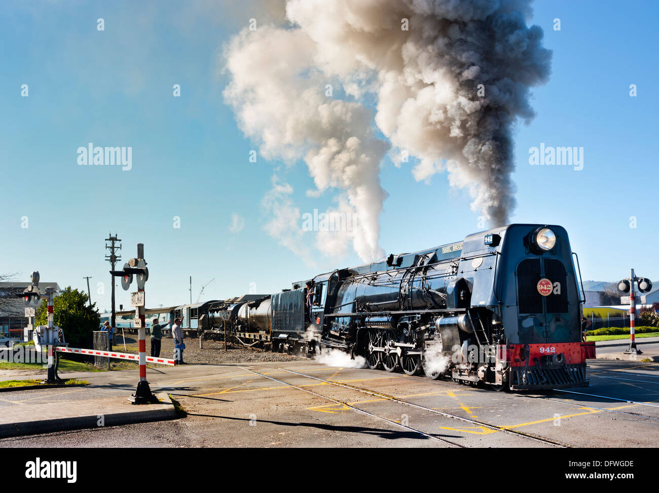 Christchurch, South Island, New Zealand. Streamlined steam locomotive KA942 leaves the station for the Tranz Alpine route to Greymouth. - Stock Image
