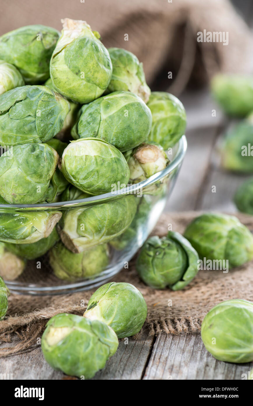 Fresh Brussel Sprouts (raw) on wooden background - Stock Image
