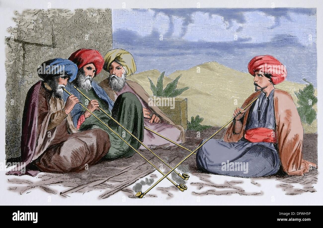 Society. Africa. Tunisia. Tunisian men, c. 1850. Engraving. Later colouration. - Stock Image