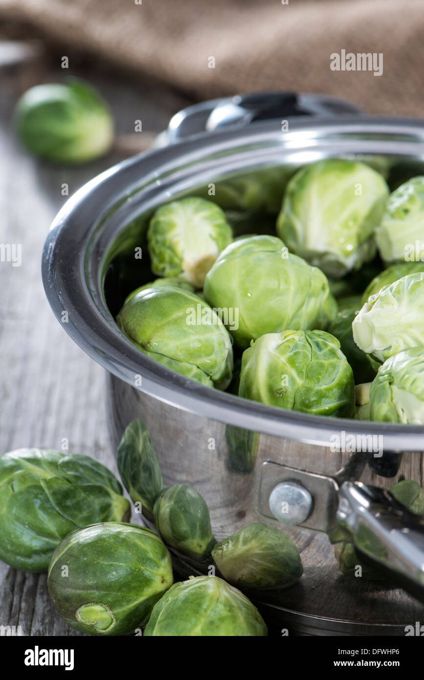Raw Brussel Sprouts in a pot - Stock Image