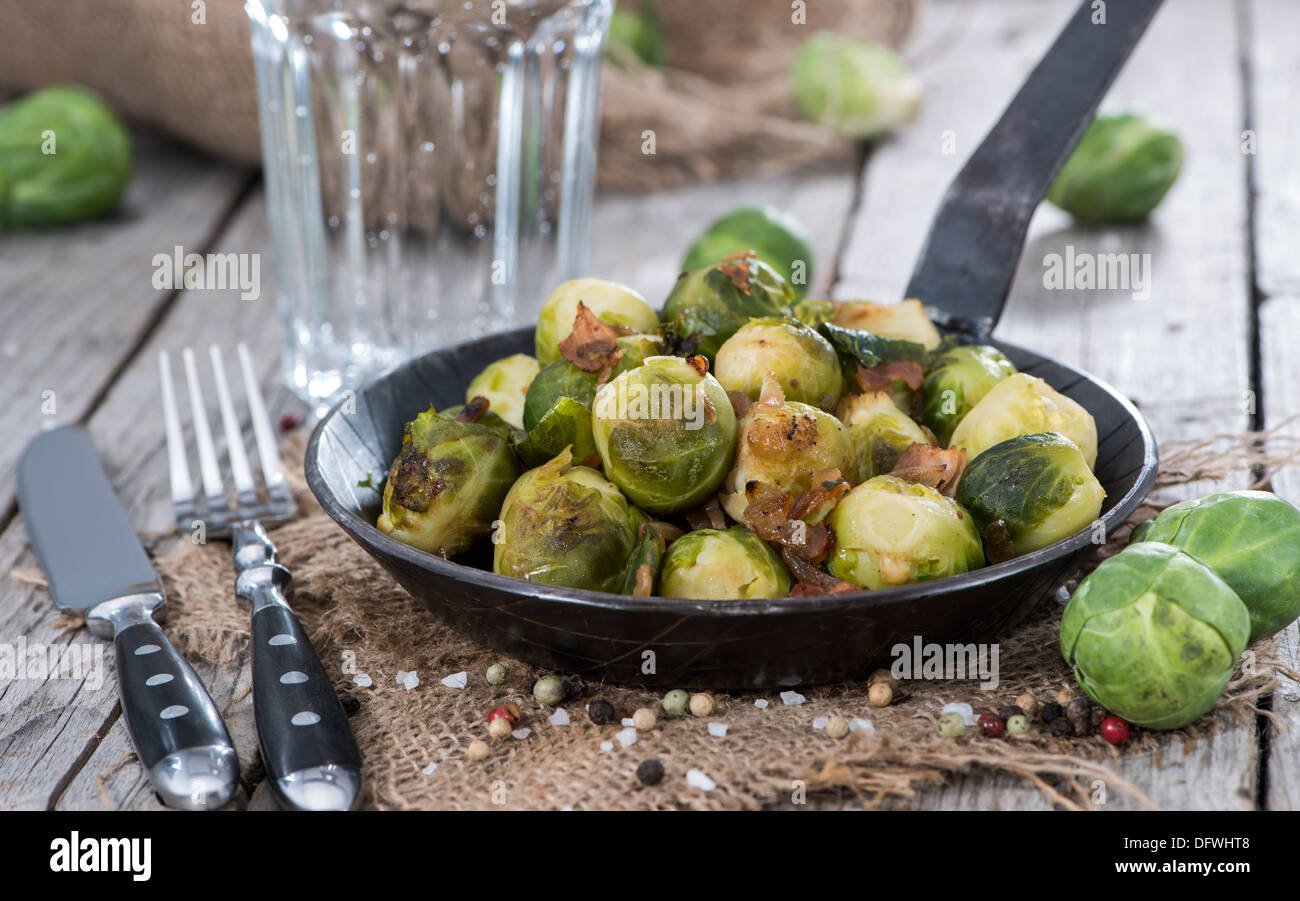 Cooked Brussel Sprouts with Ham and Onions - Stock Image