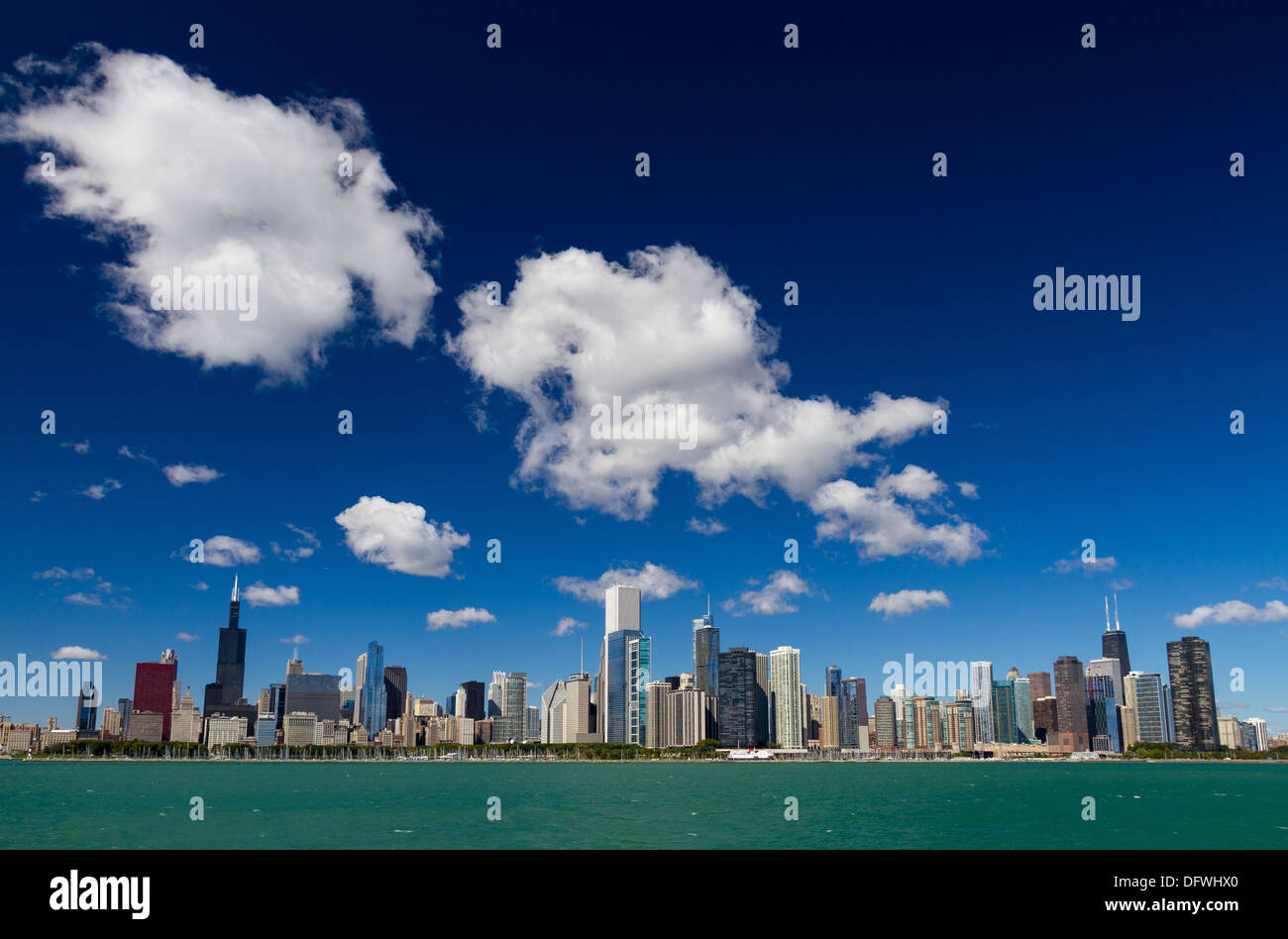 Chicago skyline with deep blue sky and fluffy clouds Stock Photo