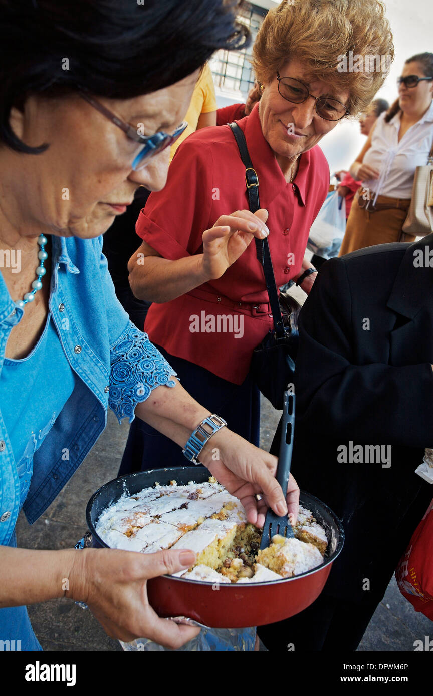 Women Sharing Cakes After Church, Plaka District Athens Greece   Stock Image