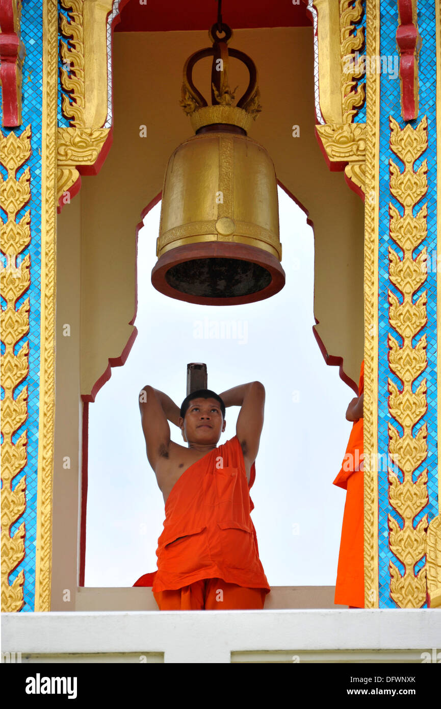 Thai buddhist monk striking a bell at temple Wat Thong Kung, beside the river Mae Khlong, Amphawa, Samut Songkhran, - Stock Image